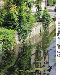 Mirroring of a timbered house in a water