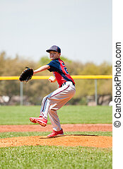 Teen baseball player throwing a pitch