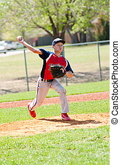 Teen baseball pitcher throwing the pitch