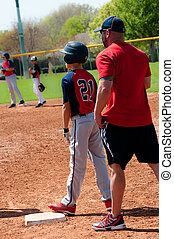 Teen baseball player and coach - Teen baseball player and...