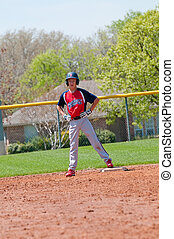 Teen baseball player on base - Teen baseball boy standing on...