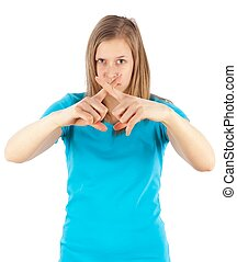 Not permitted - Young woman showing with her fingers an X...