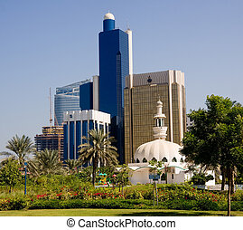Mosque in front of office buildings in Abu Dhabi - Group of...