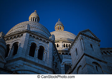 Sacre Coeur Cathedral at night, Paris France - Domes of...