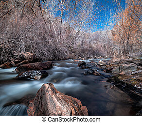 River Rock - River flowing through and around rocks with big...