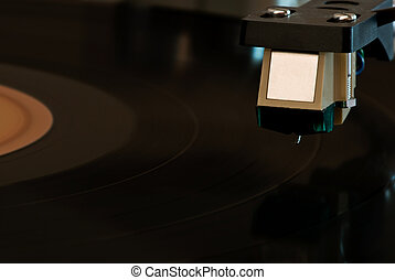 Record Player - An old record player with needle hovering...