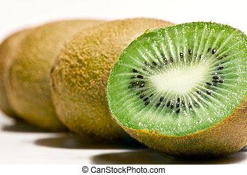 Row of Kiwi fruit - 4 kiwi fruit lined up, isolated on white...
