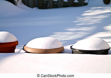 Winter Pots - Pots ladened with snow int eh backyard