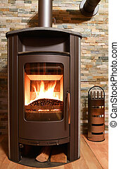 Wood burning stove in front of stonwall
