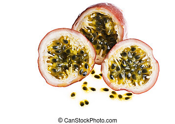 Passionfruit cut into peices, with seeds. Isolated on white.