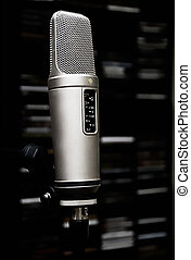 Microphone. - A studio Mic with out of focus CD rack in the...