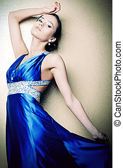 rhinestones - Beautiful young woman in a luxurious dress...