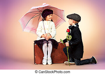 sincerity - Cute little boy is giving a rose to the charming...