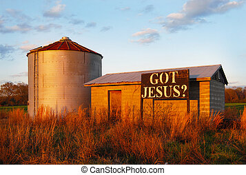 Sign on farm building: Got Jesus - Sign near a farm silo and...