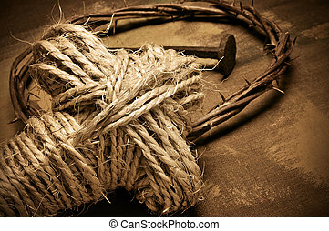 rope cross, crown of thorns and nails - closeup of a...