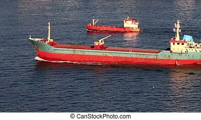 Red cargo ships