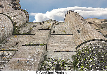 Fortress walls abbey of Mont Saint Michel. Normandy, France...
