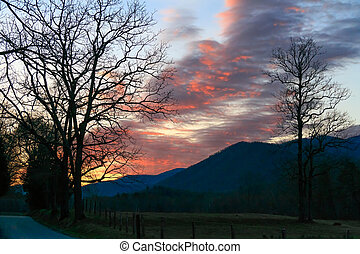 Dawn at Cades Cove - The rising sun colors the morning sky...