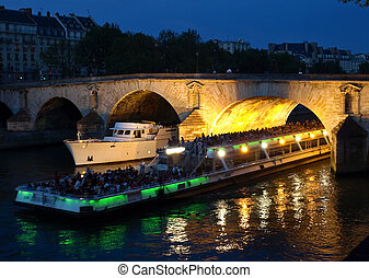 Boats on the night Seine in Paris