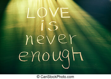 Love is never enough, conceptual words on blackboard