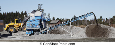bulldozer, sand and gravel industry - bulldozer loading sand...