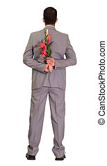 Romance - Full body view of a man wearing a suit holding...