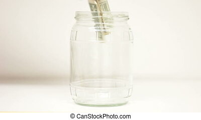 Savings Euros with Dollars in jar - Putting euro and dollar...