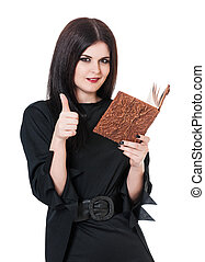 Self-satisfied witch with book of spells and okay gesture...