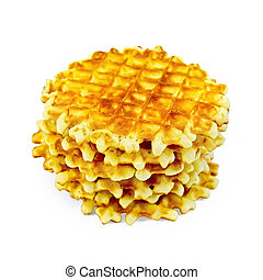 Waffles circle golden stack - A stack of golden round...