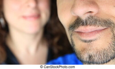 Smiling - Caucasian man and woman smiling, focus on man lips