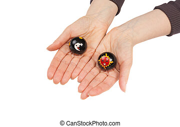 Baoding balls in a female hands isolated on white background