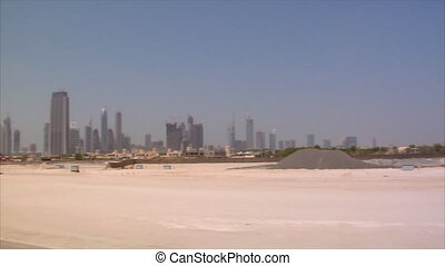 Dubai skyline pan burj emirates - DUBAI - SEPTEMBER 8: A pan...