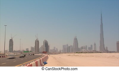 Dubai skyline time lapse burj - time lapse traffic in front...