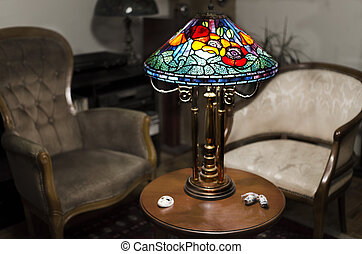 Tiffany lamp on wooden table