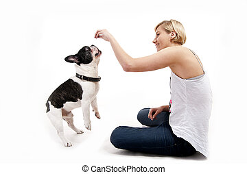 Woman with her dog playing