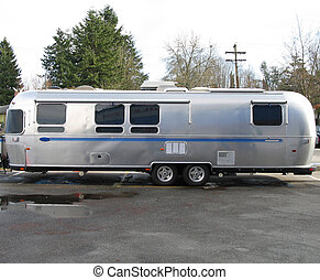 old silver and blue caravan