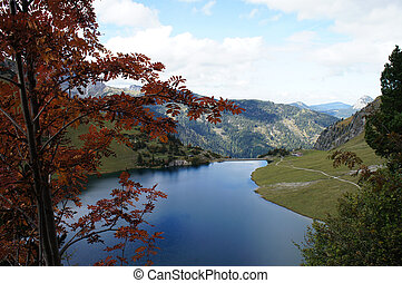 Mountain lake in autumn - The Tannheim Mountains in Tyrol,...