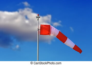 windsock over blue sky - red and white windsock over blue...