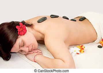 pretty woman at spa - pretty female at spa center, stones...