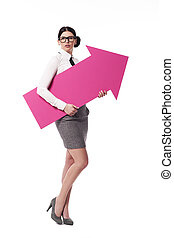 Gorgeous businesswoman holding pink arrow sign