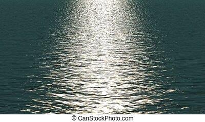 white light reflecting on ocean.