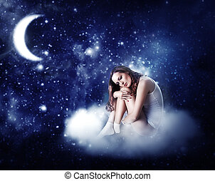 young beautiful woman sleeping on a fairy cloud in a starry...