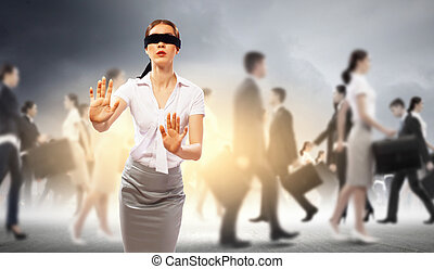 Businesswoman in blindfold among group of people - Image of...