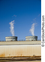 Two Smoke Stacks - Stacks at a California energy plant in...
