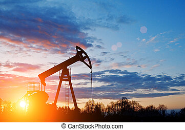 oil pump silhouette on sunset sky