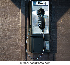 pay phone on side of building - front view of pay phone...