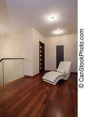 Travertine house - armchair on a corridor - Travertine house...