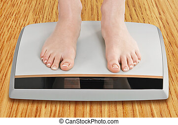 scales - women legs on electronic scales