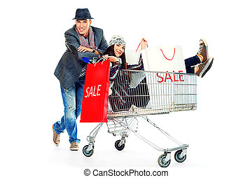 bargain sale - Cheerful couple with a shopping trolley...