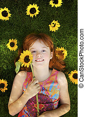 little girl with sunflowers - little red headed girl with...